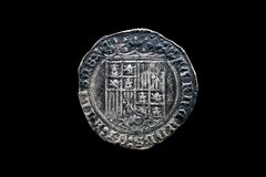 Silver coin of the spanish Catholic Kings isolated on black Stock Photos