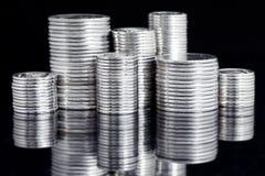 Silver coin stack on black Stock Photos