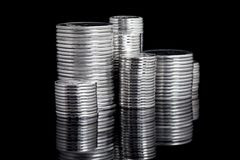 Silver coin stack on black Royalty Free Stock Photography