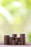 Silver coin stack in business growth concept on wood floor. Stock Images
