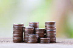 Silver coin stack in business growth concept on wood floor. Royalty Free Stock Photo