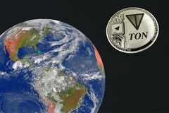 Silver coin ton is flying in the space to the earth. Elements of this image furnished by NASA Stock Photo