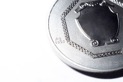 Silver coin on a white background Stock Images