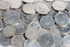 Silver coins. Spread out on a table, British currency Royalty Free Stock Image