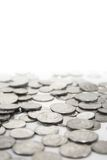 Silver coins. Spread out on a white surface Royalty Free Stock Photography