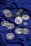Silver coins. On blue background stock photos
