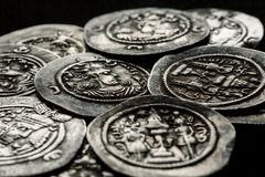 Silver coins af ancient Persia on a black background. Selective focus, close-up shot Stock Photo