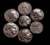 Silver coins of ancient Greece on a black background Stock Photos