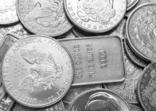 Silver coins and bars background stock photo