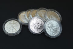 Silver coins on black background Stock Photos