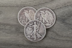 Silver Coins on Old Wood Royalty Free Stock Photo