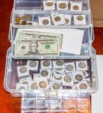 Silver coins and paper money Royalty Free Stock Photography