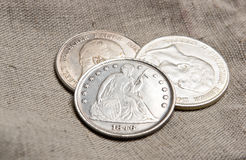 Silver coins on sack Stock Photos