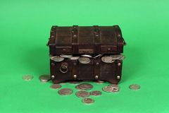 Silver Coins Spilling Out Of Wooden Treasure Chest stock photos