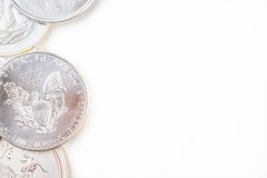 Silver coins on white background Royalty Free Stock Images