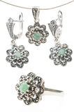 Silver collection with emerald gemstone Stock Photos
