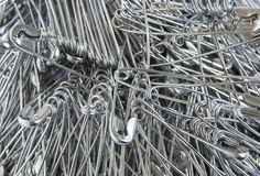 Silver colored big safety pins Royalty Free Stock Images