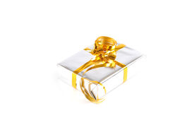 A silver colored gift box with yellow ribbon. On a white background stock photo