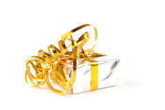 A silver colored gift box with a yellow ribbon. On a white background stock photography