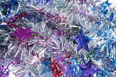 Silver with colors tinsel background Royalty Free Stock Photos
