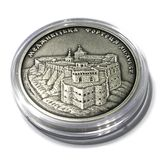 Silver commemorative coin Medzhybizh Castle of Ukraine. Silver commemorative coin Architectural Monuments of Ukraine Series in the capsule. Medzhybizh Castle. It stock photography