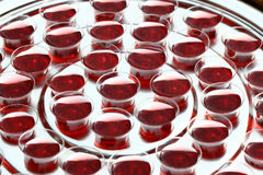Silver communion cups with red wine Stock Photos