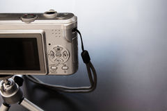 Silver compact digital photo camera. Stock Image