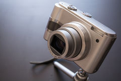 Silver compact digital photo camera. Stock Photos