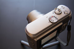 Silver compact digital photo camera. Top view royalty free stock photo