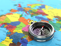 Silver compass  on world map background. Stock Images