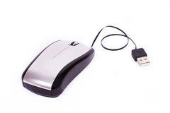 Silver computer mouse with a thin cord Stock Photography