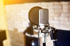 Silver condenser microphone. Music studio. Silver condenser microphone with pop filter and anti-vibration mount. Music studio. Professional sound and voice stock photos