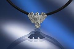 Silver condor pendant. Silver predator bird pendant hanged on leather string Royalty Free Stock Photo