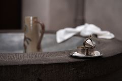 Silver containers in church for baptism on basin royalty free stock image