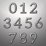 Silver convex metallic numbers on a silver background Stock Images