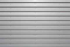 Silver corrugated metal with bolts Royalty Free Stock Images