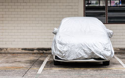 Silver cover for new car Stock Photography