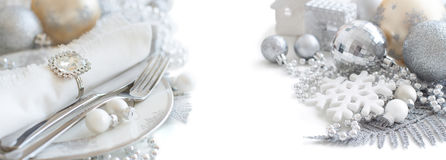 Silver and cream Christmas Table Setting Stock Images