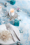 Silver and cream Christmas Table Setting with decorations Royalty Free Stock Photo