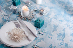 Silver and cream Christmas Table Setting with decorations royalty free stock photos
