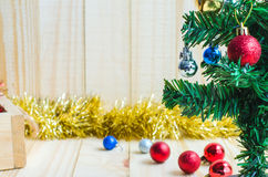 Silver crismas ball on tree  on wooden background Stock Photo