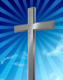 Silver cross. Silver brushed metallic cross stands in front of a blue background of clouds and sky. The background is punctuated with rays from behind the cross vector illustration