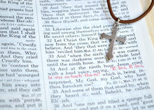 Silver cross and Good Friday Bible scripture Royalty Free Stock Images