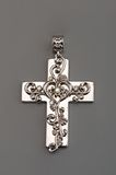 Silver cross on gray Stock Images