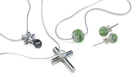 Silver cross jewelry. Silver Cross and diamonds jewelry Display on white background Stock Photo