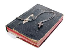 Silver cross on old bible with leather cover Stock Image