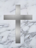 Silver cross on white marble Stock Photo