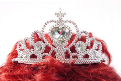 Silver crown on red hair Royalty Free Stock Images