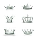 Silver crowns, set. Computer illustration on white background Stock Photos