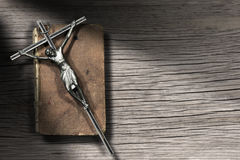 Silver Crucifix and Holy Bible on Wooden Background Royalty Free Stock Images